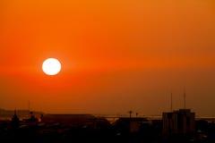 Puesta del sol anaranjada Fotos de archivo libres de regalías