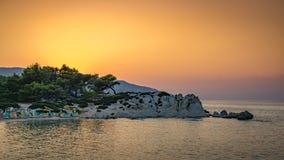 Puesta del sol anaranjada de la playa Imágenes de archivo libres de regalías