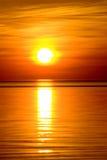 Puesta del sol anaranjada hermosa Fotos de archivo