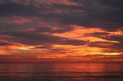 Puesta del sol anaranjada hermosa Imagenes de archivo