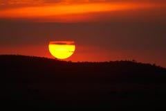 Puesta del sol anaranjada pintoresca Foto de archivo