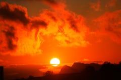 Puesta del sol anaranjado oscuro Foto de archivo libre de regalías