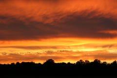 Puesta del sol brillante del país Foto de archivo libre de regalías
