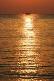 Puesta del sol bronceada Imagenes de archivo