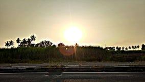 Puesta del sol del camino Imagenes de archivo