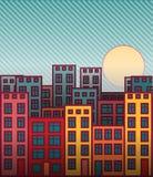 Puesta del sol colorida del paisaje urbano de las casas de la historieta Imagen de archivo libre de regalías