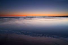 Puesta del sol colorida sobre el mar Imagen de archivo