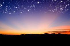 Puesta del sol con la estrella Foto de archivo libre de regalías