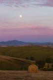 Puesta del sol con la luna Imagen de archivo