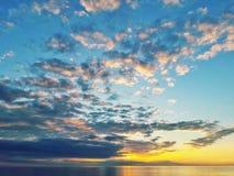 Puesta del sol con las nubes Imagen de archivo