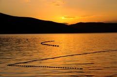 Puesta del sol con las redes de pesca Imágenes de archivo libres de regalías