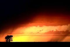 Puesta del sol con lluvia Imágenes de archivo libres de regalías