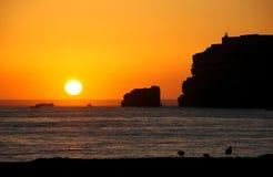 Puesta del sol con los acantilados Foto de archivo libre de regalías
