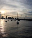 Puesta del sol con los botes pequeños Foto de archivo