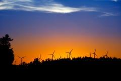 Puesta del sol con los molinoes de viento Imágenes de archivo libres de regalías