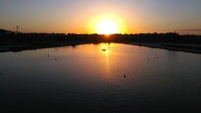 Puesta del sol con los patos Imagen de archivo libre de regalías