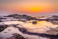 Puesta del sol coralina fotografía de archivo