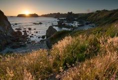 Puesta del sol costera foto de archivo