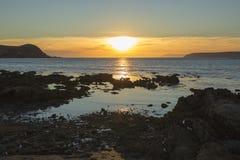 Puesta del sol costera Imágenes de archivo libres de regalías