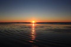 Puesta del sol costera Fotografía de archivo libre de regalías