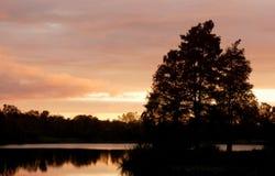 Puesta del sol de Alicia del lago Imagenes de archivo