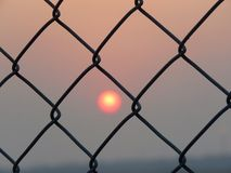 Puesta del sol de barras Foto de archivo