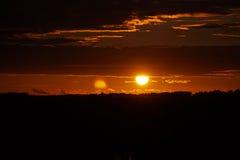 Puesta del sol de Cloudly Imagen de archivo libre de regalías
