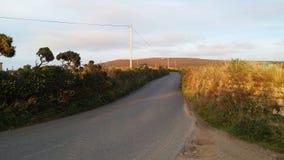Puesta del sol de Dorset, y camino rural Foto de archivo libre de regalías