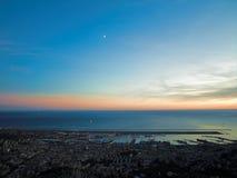 Puesta del sol de Génova en puerto Foto de archivo
