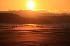 Puesta del sol de la bahía de Budle imagen de archivo