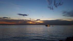 Puesta del sol de la bahía de Manila Imagenes de archivo