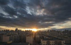 Puesta del sol de la ciudad en China, Harbin Imagen de archivo