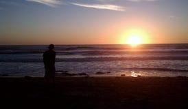Puesta del sol de la costa oeste Foto de archivo libre de regalías