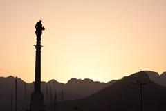 Puesta del sol de la estatua Foto de archivo