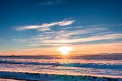 Puesta del sol de la granja de la nieve Imagen de archivo libre de regalías