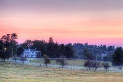 Puesta del sol de la granja del caballo fotografía de archivo libre de regalías