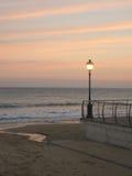 Puesta del sol de la lámpara de calle Fotos de archivo libres de regalías