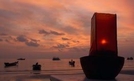 Puesta del sol de la lámpara de petróleo Imagenes de archivo
