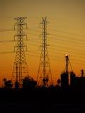 Puesta del sol de la línea eléctrica Foto de archivo libre de regalías