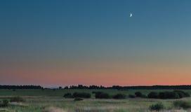 Puesta del sol de la luna Fotos de archivo libres de regalías