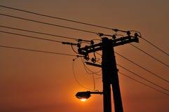 Puesta del sol de la luz de calle Foto de archivo libre de regalías