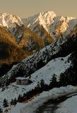 Puesta del sol de la montaña de la nieve Imagen de archivo