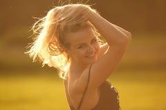 Puesta del sol de la muchacha Foto de archivo