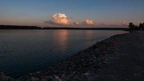 Puesta del sol de la orilla Imagen de archivo libre de regalías