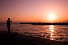 Puesta del sol de la pesca Fotografía de archivo