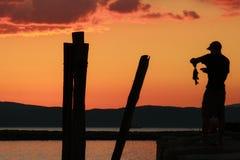 Puesta del sol de la pesca Fotos de archivo