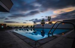 Puesta del sol de la piscina Imagen de archivo libre de regalías