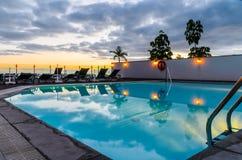 Puesta del sol de la piscina Fotografía de archivo libre de regalías