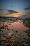 Puesta del sol de la piscina de la roca Imagen de archivo libre de regalías