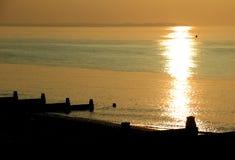 Puesta del sol de la playa de la sepia del vintage Fotografía de archivo